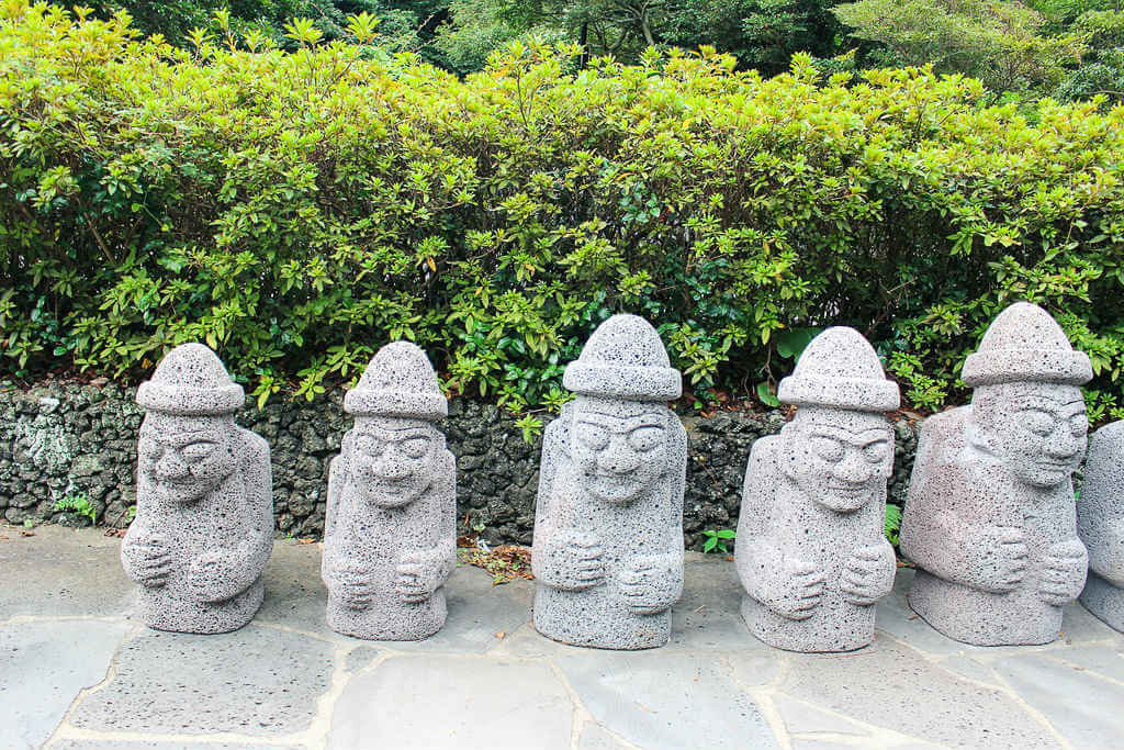 Dol Hareubangs - the symbol of Jeju. These rock statues are considered to be gods offering protection