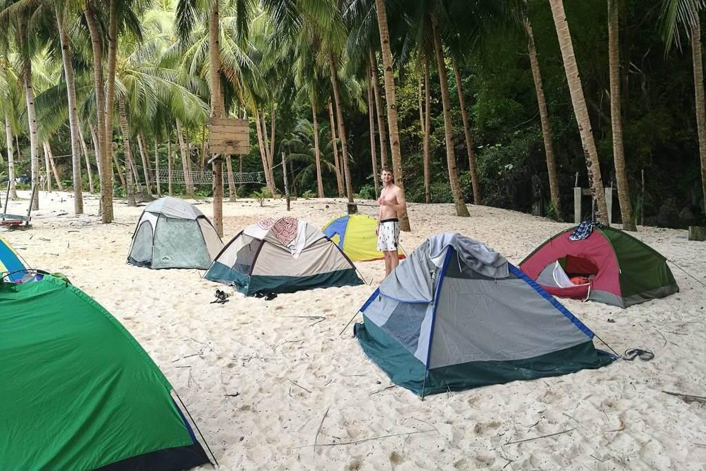 Beach camping on Seven Commandos Beach in El Nido