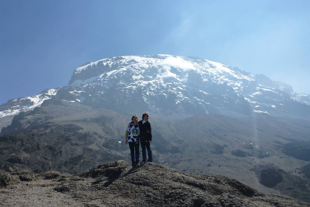Standing in front of Mt Kilimanjaro in Tanzania