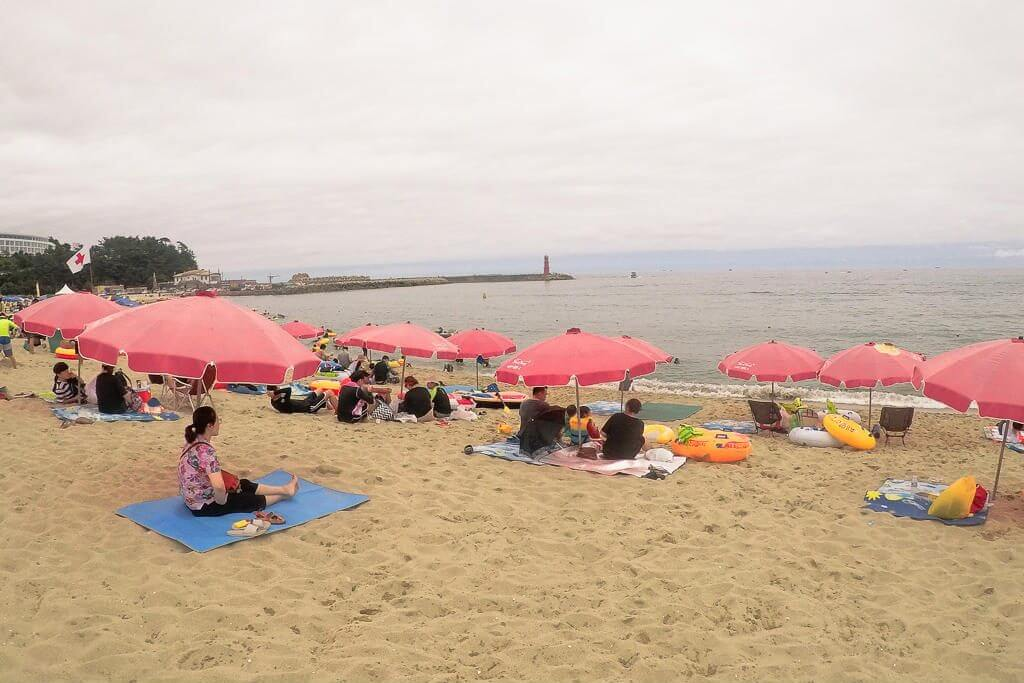 Beaches in Korea are lined with hundreds of umbrellas and tents