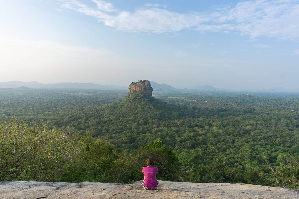 Sitting on Pidurangala Rock, overlooking Sigiriya Rock in the distance