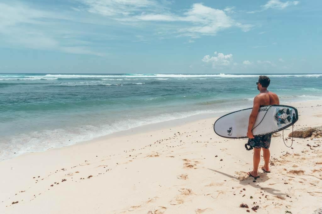 Surfing at Green Bowl Beach in Uluwatu